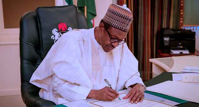 Breaking: Buhari signs minimum wage bill into law